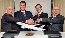 Boeing and Transaero executives celebrate the deal aboard the 787 Dream Tour plane over Russia. From left: Alexander Krinichansky, Transaero Airlines executive director; Alexander Pleshakov, Transaero Airlines chairman of the board; Marty Bentrott, vice president of Sales for Middle East, Russia and Central Asia, Boeing Commercial Airplanes; Serdar Gurz, director international Sales, Boeing Commercial Airplanes. (Photo by Boeing)