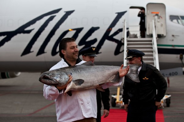 Frank Ragusa, general manager of Ocean Beauty Seafoods, holds up the prized salmon to the crowd. (Photo by Jeremy Dwyer-Lindgren/NYCAviation)