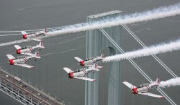 Geico Skytypers buzz the Verrazano Narrows Bridge. (Photo by Scott Snorteland/srsimages.com)