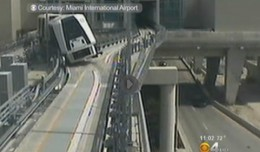 Surveillance video shows the people mover leaning to its side after losing a wheel. (Photo by Miami International Airport, via CBS Miami)