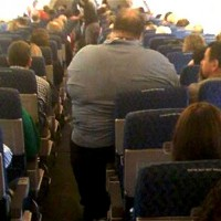 obese-man-on-plane-630