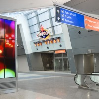 Terminal 3 is adorned with colorful signage. (Courtesy of Clark County Department of Aviation)