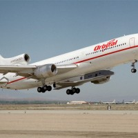 English: Mounted under the fuselage of a modified Lockheed L-1011, the Orbital Sciences X-34 technology demonstrator is taken aloft for its first captive carry flight. (Photo by NASA/Tony Landis)