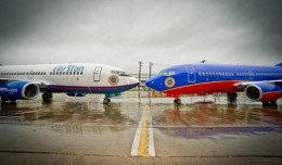 Southwest and AirTran Boeing 737s nose to nose. (Photo by Southwest Airlines)