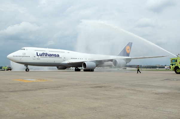 Lufthansa's first Boeing 747-8 Intercontinental (D-ABYA) receives a water cannon salute upon arrival at Washington Dulles. (Photo by Cary Liao/NYCAviation)