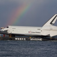 Enterprise meets a rainbow in New York Harbor. (Photo by Wavefront)