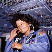 Sally Ride communicates with ground controllers from the flight deck of Space Shuttle Challenger during her first mission in space, STS-7. (Photo by NASA)