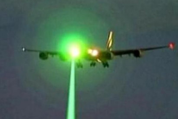 Green laser shining on an aircraft. (Photo by Dept of Transportation)