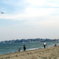 A Southwest Airlines jet on approach to Logan Airport passes over Revere Beach. (Photo by Sara Jeanne Edwards via Flickr, CC BY-NC-SA)