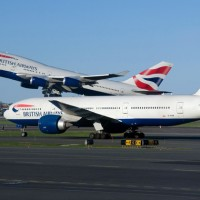 British Airways Boeing 747 and 777s cross paths at Boston's Logan International Airport. (Photo by Eric Dunetz)