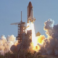 First launch of Space Shuttle Discovery, Mission STS-41-D. (Photo by NASA)