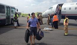 Passengers evacuate US Airways Flight 3652 at Reagan National. (Photo by Sarah Dunn via Twitter)