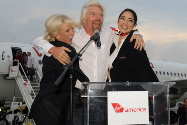Virgin Group founder Sir Richard Branson celebrates at the launch of PSP service last winter. (Photo by Virgin America)