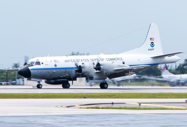 "NOAA Lockheed WP-3D Orion (N42RF ""Kermit"") lands at Fort Lauderdale following a sortie through two dangerous tropical systems. (Photo by Mark Lawrence)"