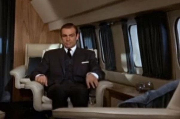 James Bond is about to give Goldfinger a physics lesson.