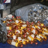 Thousands of the recovered bottles of liquor were displayed at a press conference held by Queens District Attorney Richard Brown. (Photo by Queens DA&#039;s Office)