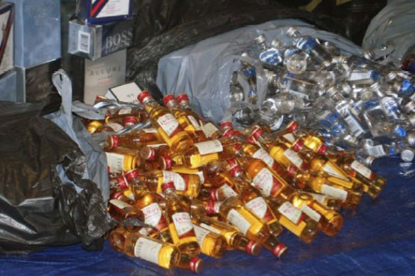Thousands of the recovered bottles of liquor were displayed at a press conference held by Queens District Attorney Richard Brown. (Photo by Queens DA's Office)