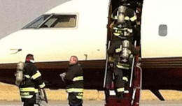 Mitt Romney campaign press secretary Andrea Saul tweeted this photo of firemen rushing onto the aircraft in Denver. (Photo via @andreamsaul)