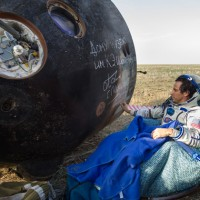 Expedition 32 NASA Flight Engineer Joe Acaba signs the side of his Soyuz TMA-04M spacecraft shortly after he landed with his Expedition 32 crewmates. (Photo by NASA/Carla Cioffi)