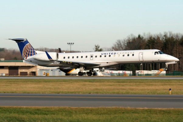 A United Express Embraer ERJ-145XR (N14125) touches down in Toronto. (Photo by Kaz T)