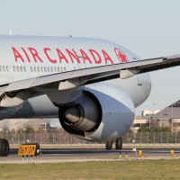 One of Air Canada's 12 existing Boeing 777-300ERs (C-FIUV) prepares to take off from Toronto. (Photo by Kaz T)