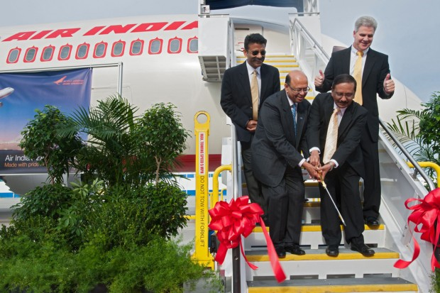 Cutting the ceremonial ribbon on Air India's second Boeing 787 (VT-ANI), from left to right:  Capt. Amitabh Singh, Air India Pilot; Dinesh Keskar, senior vice president of Asia Pacific and India Sales, Boeing Commercial Airplanes;K. M. Unni, Air India Board Member:Jack Jones, vice president and general manager, Boeing South Carolina. (Photo by Boeing)