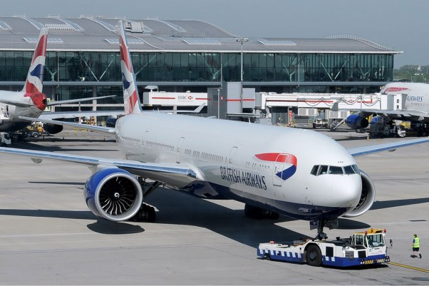 A British Airways Boeing 777-300ER (G-STBF) pushes back from a gate at Heathrow. (Photo by Ken Iwelumo via wikimedia)