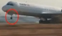 Iran Air Fokker 100 landing with nose gear failure.