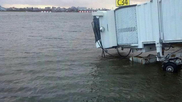 Water laps at a jetway outside LaGuardia's Central Terminal. (Photo via Fox5)