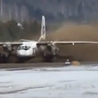 A UTAir Antonov An-24 does its best monster truck impression.