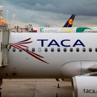 TACA Airbus parked at a gate. (Photo by Frederick Durand via wikimedia, CC-BY-SA)