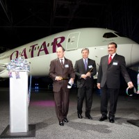 The first Qatar Airways Boeing 787 Dreamliner poses behind Boeing Commercial Airplanes CEO Ray Conner, Qatar Airways CEO Akbar Al Baker and Qatari Ambassador to the United States His Excellency Mohamed Bin Abdulla Al-Rumaihi. (Photo by Liem Bahneman/NYCAviation)