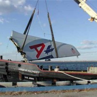 The vertical stabilizer of American Airlines Flight 587 is lifted out of Jamaica Bay. (Photo by NTSB)