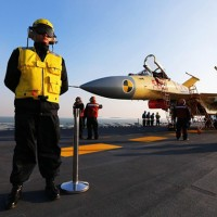 A carrier-borne J-15 fighter jet on Chinas first aircraft carrier, the Liaoning. (Photo by Xinhua News Agency)