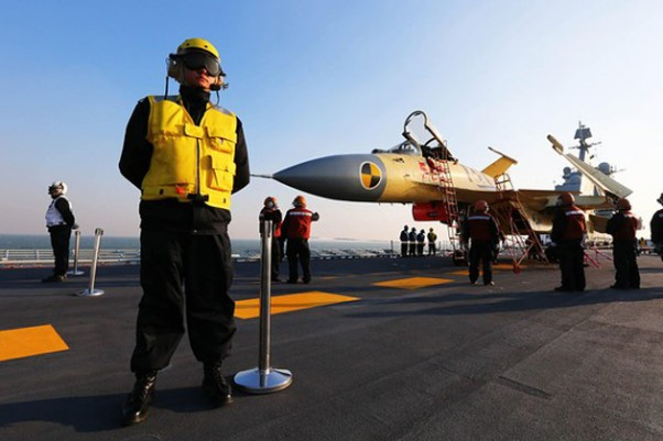 A carrier-borne J-15 fighter jet on China's first aircraft carrier, the Liaoning. (Photo by Xinhua News Agency)