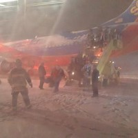 Southwest Airlines Flight 1905 after skidding off runway in Denver. (Photo by @mrbuddylee via Twitter)
