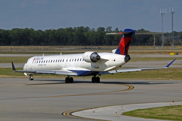 A Delta Connection Bombardier CRJ-900 operated by Mesaba Airlines. (Photo by caribb via Flickr, CC-BY-NC-ND)