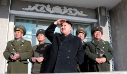 Kim Jong-un watches something in the sky. (Photo by Korean Central News Agency)