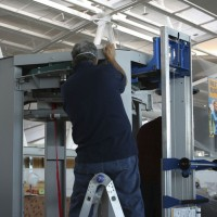 A technician assembles a brand new TSA body scanner. (Photo by Matt Molnar/NYCAviation)