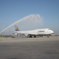 Lufthansa's first 747-8I service to Los Angeles gets a water cannon salute. (Photo by Stephen Shrank/NYCAviation)