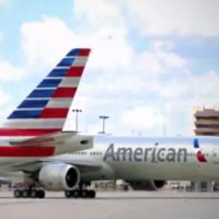 Some (renderings of) newly painted American jets rolling around an airport. (Screengrab from AA video)