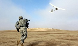 A US Army sergeant launches a AeroVironment RQ-11Raven unmanned aerial vehicle, similar to the drones being sold to the Afghani government. (Photo by Sgt. 1st Class Michael Guillory/US Army)