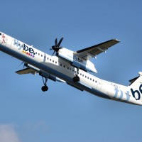 A Flybe Bombardier Dash-8-400 (G-JECL) takes off from Manchester Airport, England. (Photo by Arpingstone via wikimedia)