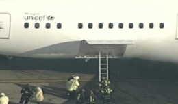 Smoke is seen in the rear cargo door of the Japan Airlines Boeing 787. (Screengrab from WHDH video)