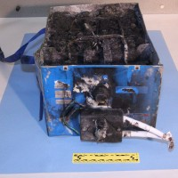 These are the remains of the lithium-ion battery that burst into flames inside a Boeing 787 last week. (Photo by NTSB)