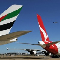 Emirates and Qantas A380 tails. (Photo by AFP)