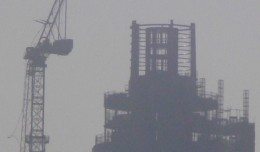 A construction crane at St. George Wharf Tower stands crippled after being hit by a helicopter in London. (Photo by David Holt via wikimedia, CC-BY-SA)