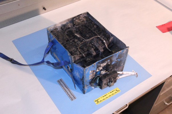 A crispy 787 lithium-ion battery under investigation. (Photo by NTSB)