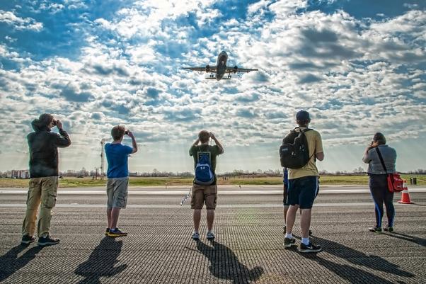 "Aviation enthusiasts ""running"" on runway 22L/4R. (Photo by Mark Szemberski )"