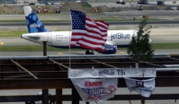 The final I-beam used in constructing the new T5i on display, with a JetBlue A320 in the background